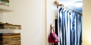 Property, Room, Interior design, Clothes hanger, Shelving, Publication, Ceiling, Bag, Shelf, Hardwood,