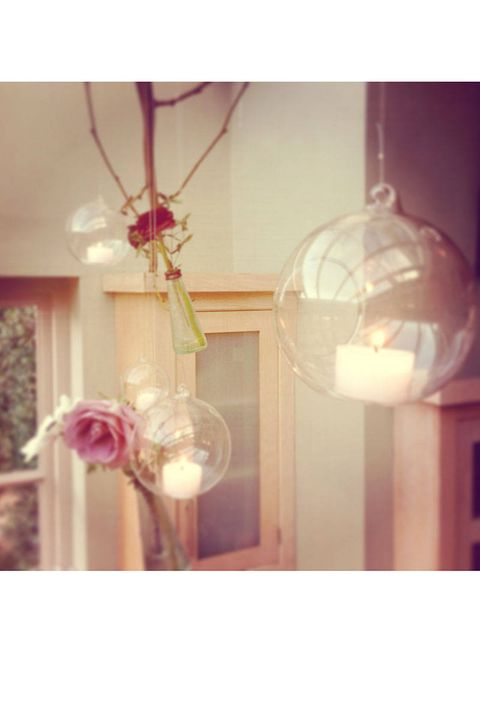 Pink, Interior design, Lighting accessory, Light, Interior design, Light fixture, Peach, Material property, Candle, Ornament,