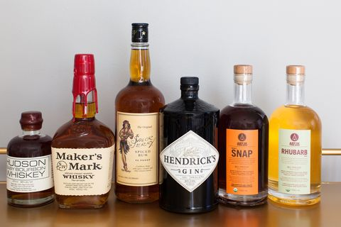 Product, Brown, Liquid, Bottle, Alcohol, Alcoholic beverage, Drink, Glass bottle, Amber, Logo,