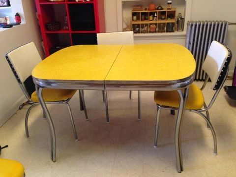 Room, Yellow, Floor, Furniture, Flooring, Interior design, Table, Chair, Hardwood, Picture frame,
