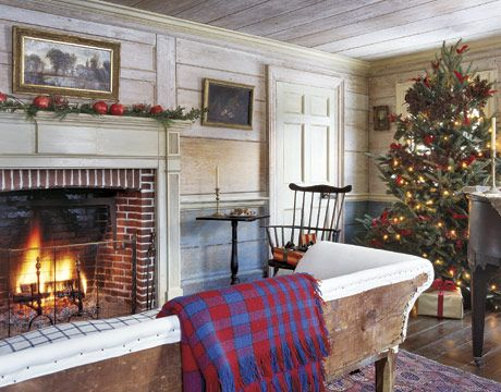 living room with christmas tree and fireplace