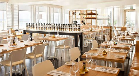 Furniture, Table, Restaurant, Interior design, Glass, Drinkware, Dishware, Chair, Barware, Tableware,