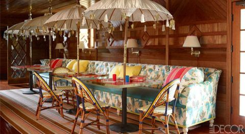 Room, Furniture, Umbrella, Lampshade, Hardwood, Shade, Outdoor furniture, Linens, Lighting accessory, Outdoor table,