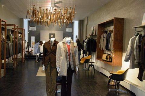 Room, Light fixture, Ceiling fixture, Chandelier, Ceiling, Fashion, Clothes hanger, Collection, Boutique, Retail,