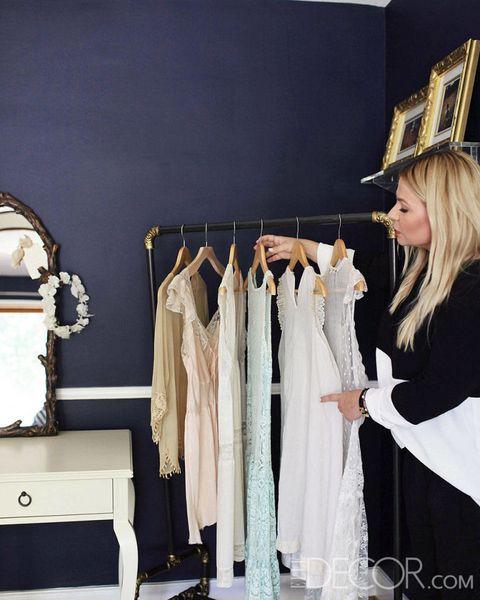 Room, Clothes hanger, Fashion, Costume accessory, Blond, Fashion design, Linens, Costume design, Boutique, Home accessories,