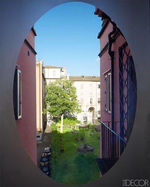 Fixture, Arch, Tints and shades, Urban design, Circle, Apartment, Daylighting, Yard, Hacienda,