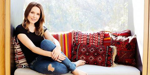 Leg, Comfort, Sitting, Denim, Thigh, Living room, Couch, Knee, Flash photography, Foot,