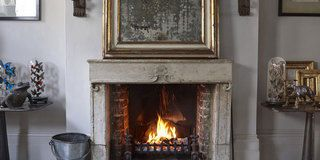 Wood, Room, Property, Hearth, Wall, Floor, Heat, Picture frame, Home, Black,