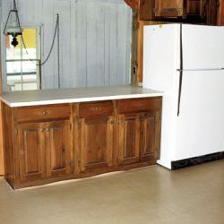 old wood kitchen with fridge