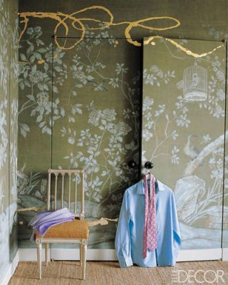 Decorator Jeffrey Bilhuber chose a hand-painted de Gournay wallpaper with a garden motif for the closet doors and walls of his Manhattan bedroom, and then commissioned artist Nancy Lorenz to add painterly flourishes in gold leaf on resin. The 18th-century French chair has an ­ostrich-covered seat.