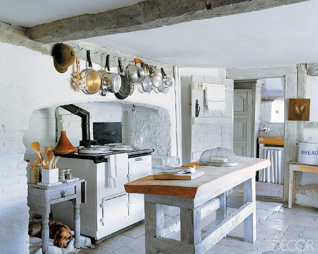 A Rough Sawn Oak Top Island And An Aga Stove Are Some Of The Sturdy  Elements In The Kitchen Of This Restored 16th Century Farmhouse In West  Sussex, England.