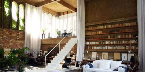 Room, Interior design, Living room, Furniture, Couch, Stairs, Wall, Shelf, Interior design, Ceiling,