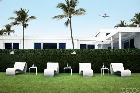 Furniture, Arecales, Real estate, Woody plant, Design, Home, Aircraft, Palm tree, Outdoor furniture, Shade,