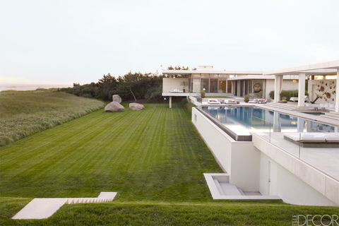 Grass, Property, Swimming pool, Real estate, Villa, Lawn, Resort, Composite material, Yard, Courtyard,