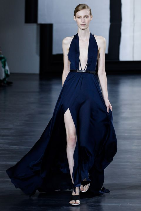 Shoulder, Fashion show, Dress, Joint, Formal wear, Style, Fashion model, One-piece garment, Runway, Fashion,