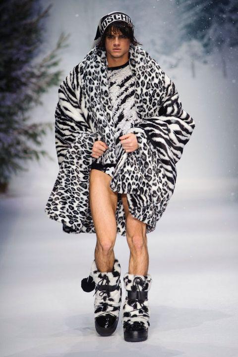 Leg, Fashion show, Shoulder, Joint, Human leg, Runway, Winter, Fashion model, Style, Pattern,