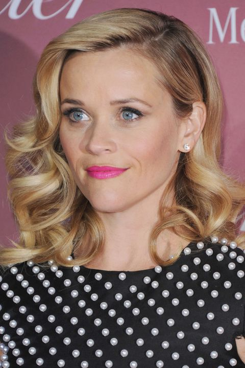 A severe side part accentuates Witherspoon's '50s-inspired retro waves.