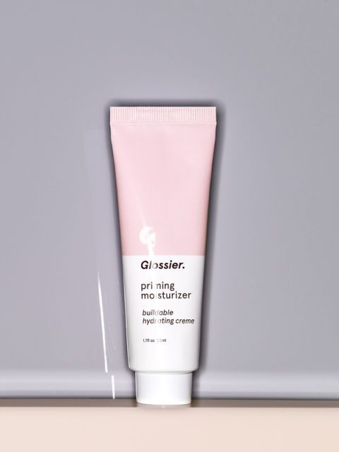 "Dewy skin has been the look du jour for the past few seasons, and we think&nbsp;the <em>second</em> best way to get that&nbsp;glow&nbsp;is with a little of this&nbsp;Glossier goodness. Apply it to your face&nbsp;before your makeup and it will plump up your skin, minimize your pores, and give you that after-sex radiance.  $25; <a href=""https://www.glossier.com/#!/products/priming-moisturizer?utm_source=ITGPrimingMoisturizer300x600"">glossier.com</a>"