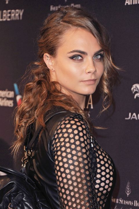 The bushy-browed beauty is a true smoke show with her charcoal-rimmed eyes and tousled waves.