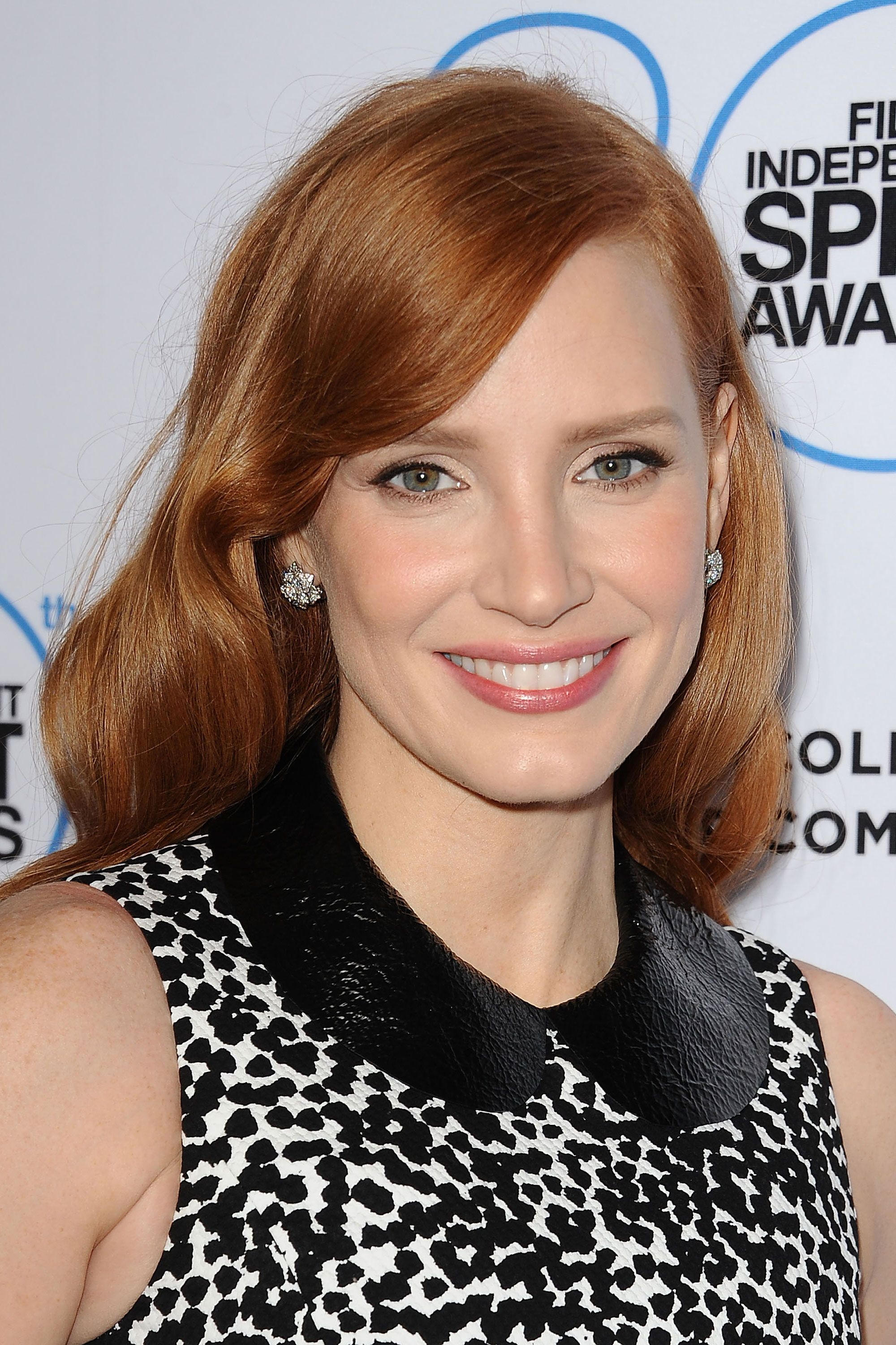 Chastain's peaches and cream complexion is the perfect complement to her auburn waves and pink pout.