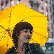 Camille with umbrella