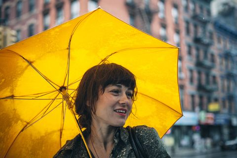 Always concerned with aesthetics, Becerra carries a yellow umbrella  because she likes the way it makes her stand out on a gray, gloomy day. (No wonder her platings are such perfection.)