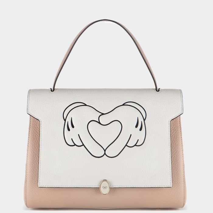 "Anya Hindmarch Heart Hands Small Satchel, $1,137; <a href=""http://www.anyahindmarch.com/View-All/Heart-Hands-Small-Bathurst-Satchel/Light-Nude-5050925882576.html?start=1"">anyahindmarch.com</a>"