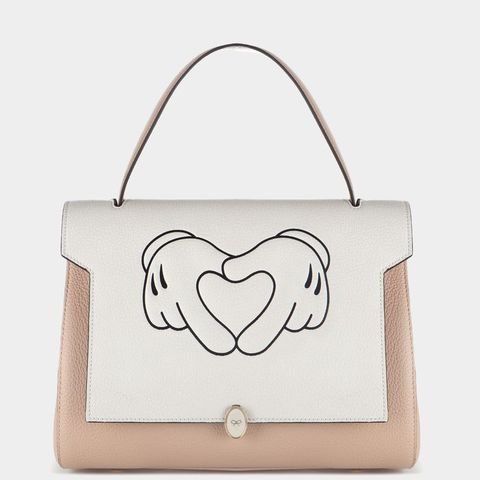 "Anya Hindmarch Heart Hands Small Satchel, $1,137; <a href=""http://www.anyahindmarch.com/View-All/Heart-Hands-Small-Bathurst-Satchel/Light-Nude-5050925882576.html?start=1"">anyahindmarch.com</a>"