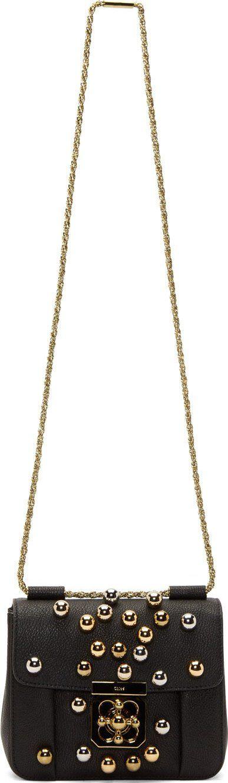 "Chloé Elsie Small Bag, $3,550;<a href=""https://www.ssense.com/women/product/chloe/black-leather-gold-silver-beaded-elsie-small-bag/416603""> ssense.com</a>  <!--EndFragment-->"