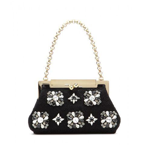 """Dolce &amp; Gabbana Sara Crystal-embellished Lace Shoulder Bag, $2,995;<a href=""""http://www.mytheresa.com/en-us/sara-crystal-embellished-lace-shoulder-bag.html""""> mytheresa.com</a>"""