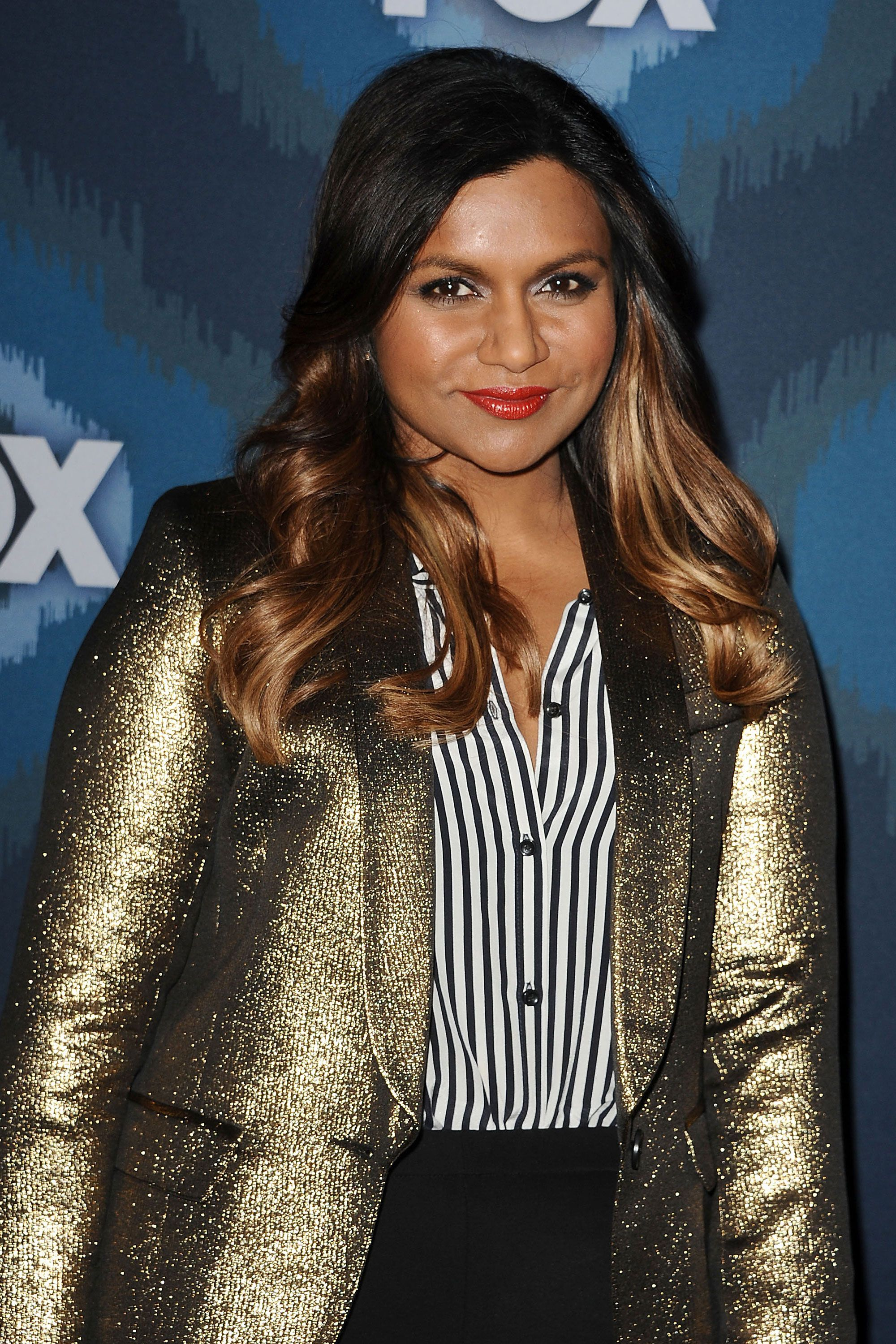 The brunette beauty lightens up her tresses with honey highlights that pair nicely with her metallic blazer.