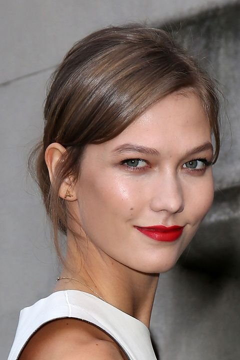 Kloss may not have been walking the runway, but she looked catwalk-ready with her dewy model skin and bright cherry pout.