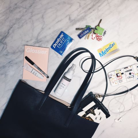 """Metrocard,&nbsp;Glossier Balm Dotcom, Rose Spray, Gum and Keys"" #5ThingsInMyBag -&nbsp;<a href=""http://instagram.com/emilywweiss"">@emilywweiss</a>"