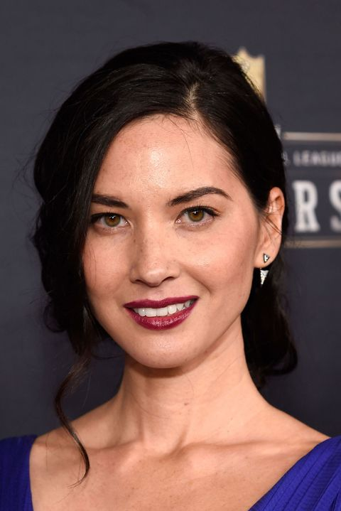 A vampy oxblood lip enhances Munn's pinned-back Old Hollywood curls.