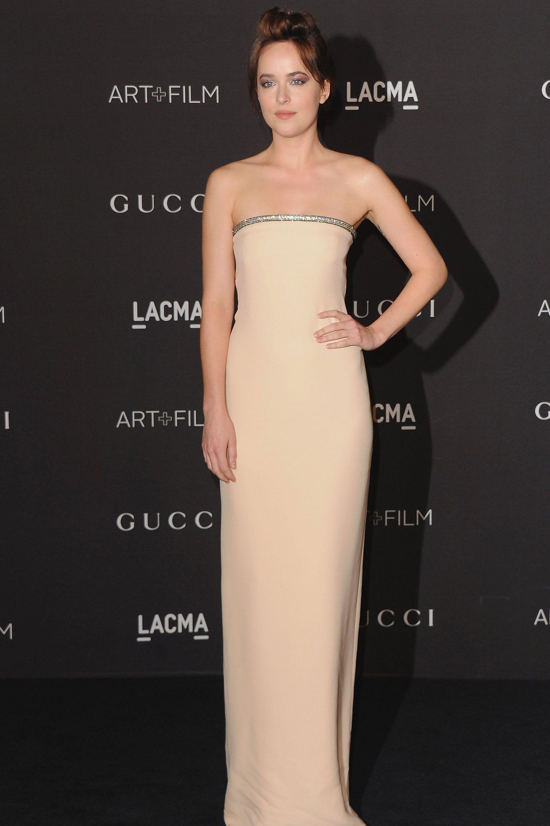 Dakota Johnson In White Prada Dress At Fifty Shades Freed Paris Premiere Fashion Photos