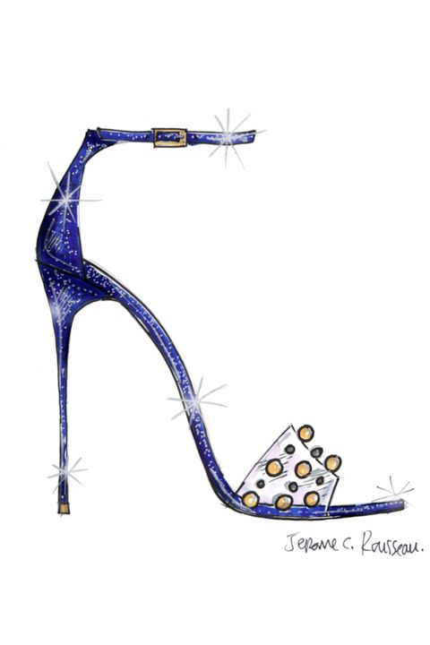 """The stroke of midnight is a wonderful element of the Cinderella fairytale; it adds tension and intensity to the story. I was inspired by that when I designed this style for Cinderella and the result is a dramatic midnight-blue glitter sandal on a sky-high heel.  The clear strap is reminiscent of the crystal slipper, while the refined gold and silver trims add the right amount of whimsy to the design. I wanted to create something that, if left behind, the Prince would feel even more captivated by Cinderella's allure."""