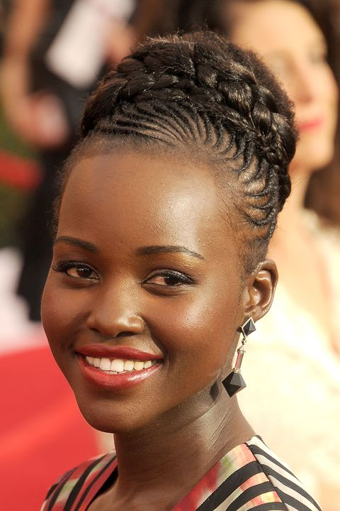 The typically short-haired actress mixed things up with a braided bun updo and cornrows at the SAG Awards.