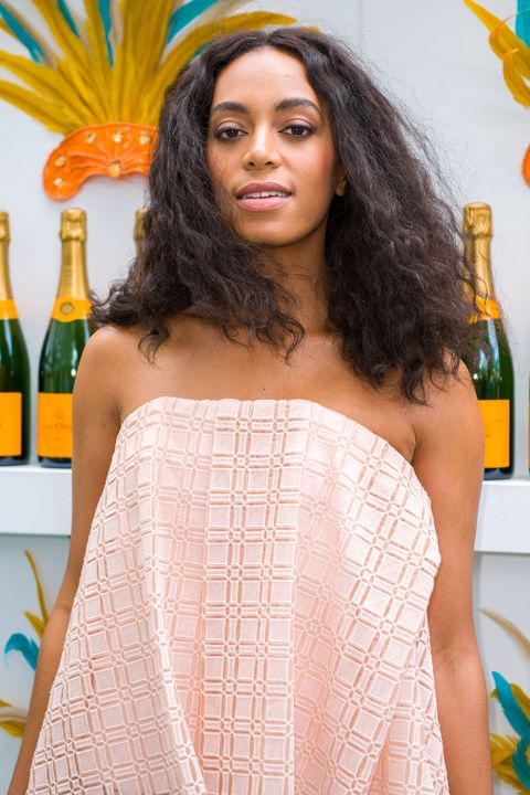 Knowles looks beach-ready with her natural waves and nearly naked face.