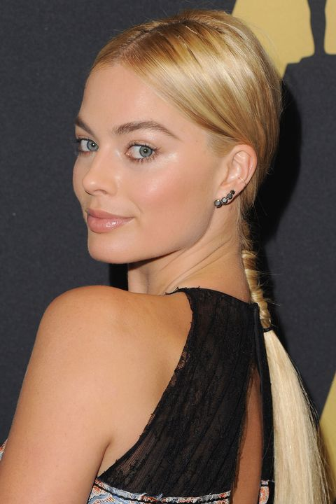 Rather than finishing off her sleek middle-parted 'do with a low chignon or ponytail, Robbie went for a whimsical French braid.