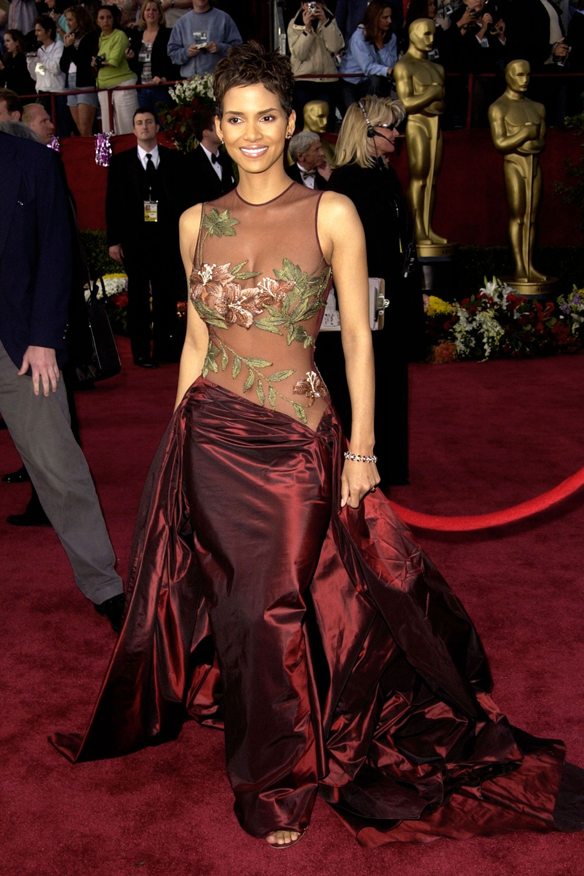 4e0c1a94c758 53 of the Most Iconic Oscar Gowns of All Time