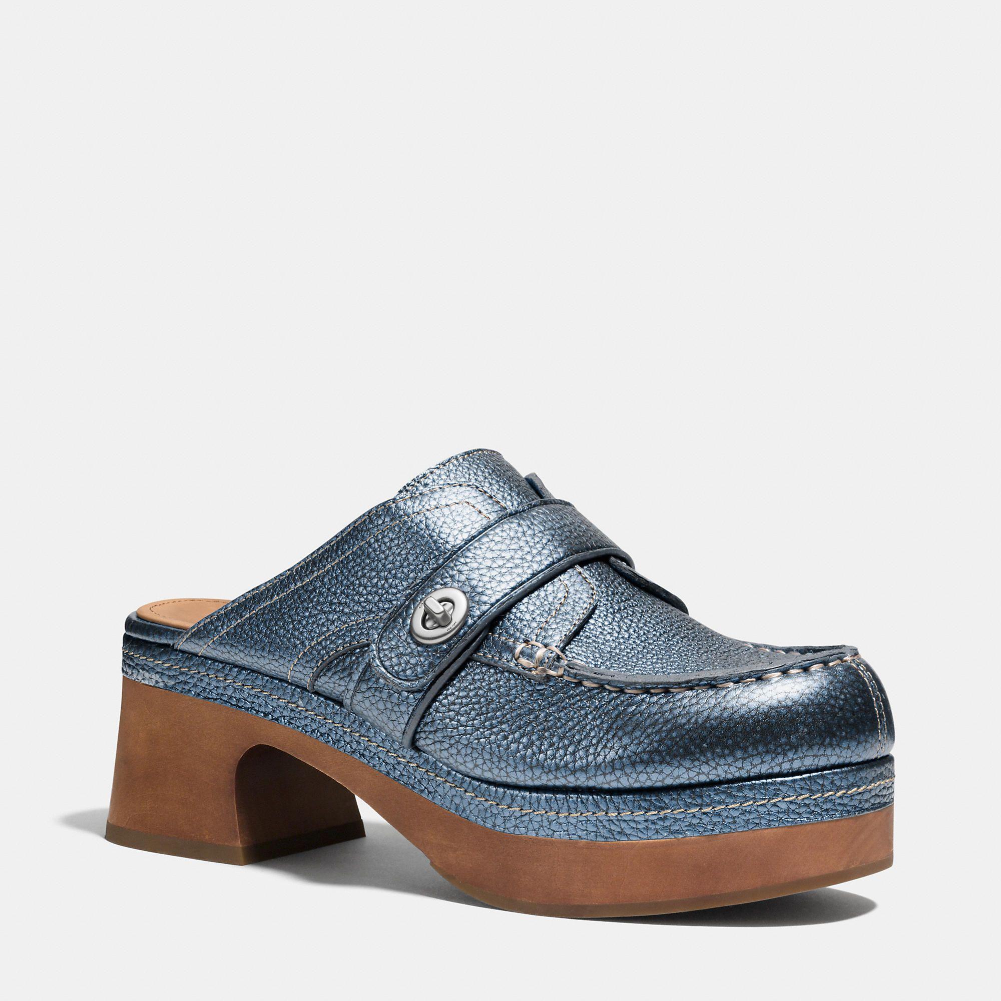 "Coach Turnlock Mid-Heel Clog, $345;&amp;nbsp;&lt;a href=""http://www.coach.com/coach-designer-clogs-turnlock-mid-heel-clog/Q7155.html?dwvar_color=E6A&amp;amp;cgid=women-shoes""&gt;coach.com&lt;/a&gt;  <!--EndFragment-->"
