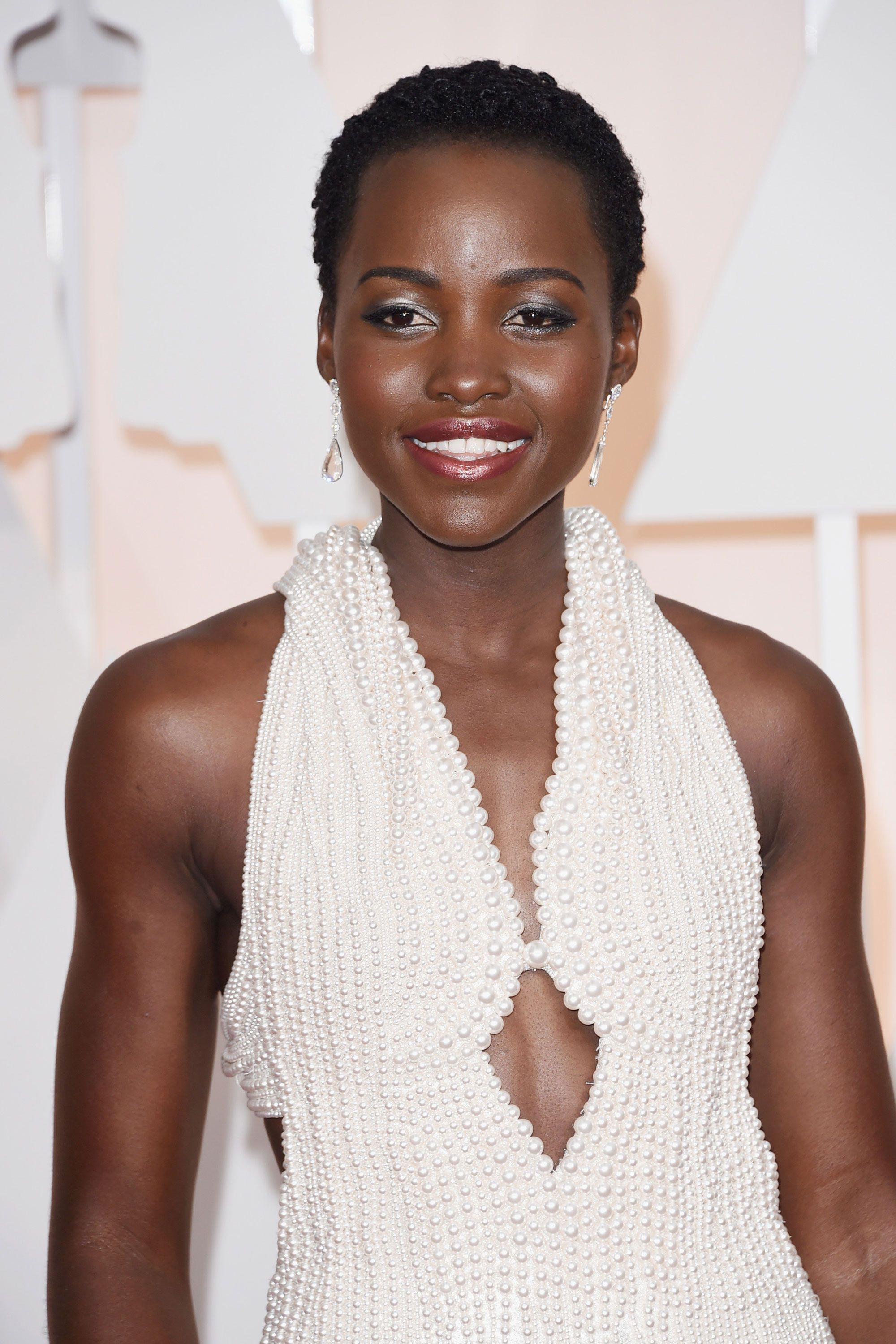 Lupita's skin couldn't look any more luminous, (though her custom pearl-covered Calvin Klein number ups her glow factor, surely).