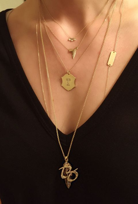 """<strong>Tell me about the charms you are wearing.</strong>  I chose&nbsp;these charms because they represent a number of the things and people&nbsp;I love. The little&nbsp;<a href=""""http://zoechicco.com/products/14k-3-bezel-set-diamond-necklace"""">three-diamond charm necklace</a>&nbsp;signifies my family: me, my son Truman (Tru), and my husband, Tim.&nbsp;I made the&nbsp;<a href=""""http://zoechicco.com/products/14k-pave-shield-initial-disc-necklace"""">T shield charm</a>&nbsp;several years ago to represent my husband, Tim, but since having Tru, I've been wearing this necklace every day. It's nice that they have the same first initial and one piece of jewelry can represent both the men in my life. While it has worked out well, I promise, we didn't choose Truman's name because I already had a lot of T jewelry. The&nbsp;<a href=""""http://zoechicco.com/products/14k-long-id-necklace"""">14-karat gold long floating ID necklace</a> says&nbsp;""""BREATHE"""" on one side and """"RELAX""""&nbsp;on the flip side. I made this piece for myself as it's a good reminder to slow down, enjoy the special moments, and not sweat the small stuff.&nbsp;The gold pavé diamond&nbsp;<a href=""""http://zoechicco.com/products/14k-pave-sharks-tooth-necklace"""">shark tooth&nbsp;</a>symbolizes strength and reminds me of my home in California and the beach.&nbsp;The long&nbsp;<a href=""""http://zoechicco.com/products/14k-pave-feather-necklace"""">feather</a>&nbsp;charm is one of my favorites.&nbsp; It has black diamonds on one side and white diamonds on the other. It's solid gold and has a really nice weight to it. For me, the feather represents flight and the ability to move more freely in life. The pavé diamond ZT charm is our initials intertwined, and it's the monogram that my husband and I designed together for our wedding. It's such a special piece and I receive so many compliments whenever I wear it, even though most people can't really tell what it is (which I kind of like).&nbsp;Tim worked with my team to have it made and the"""