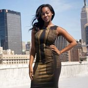 Hairstyle, Sleeve, Human body, Shoulder, Tower block, Urban area, Tower, Building, Metropolitan area, City,