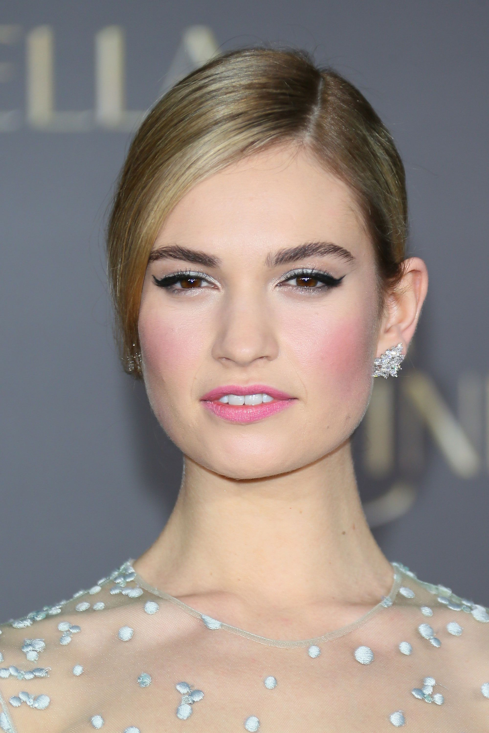 The <em>Cinderella</em> star looks like a true princess with her polished bun, rosy cheeks, and pink pout.