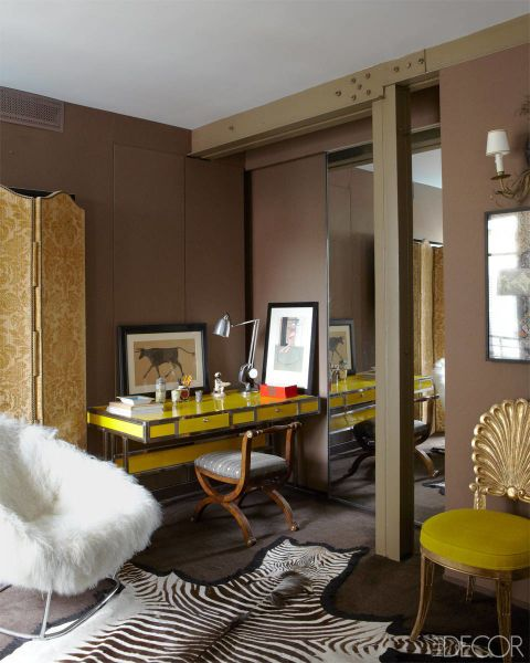 """This bold sitting area combines color, texture and pattern in one cohesive, stylish space. The armchair by Carlo Colombo and a 1970s French desk are paired with a Biedermeier chair; the walls are painted in Farrow & Ball's Brinjal.  <a href=""""http://www.elledecor.com/design-decorate/house-interiors/g1033/sig-bergamin-paris-apartment/"""">See the rest of the home</a>."""