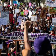 Human, People, Crowd, Pink, Purple, Protest, Public event, Rebellion, Banner, Fan,