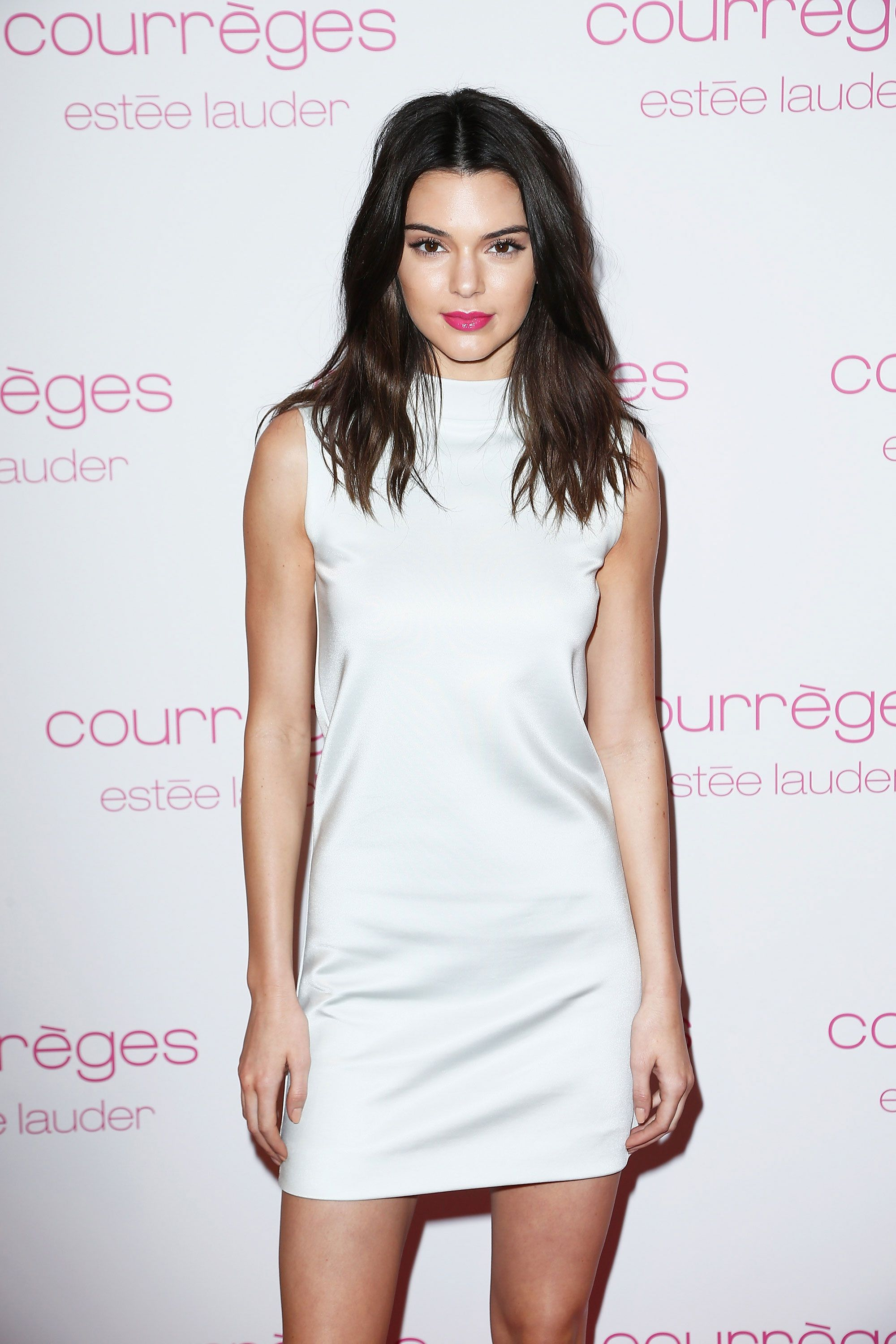 Jenner takes a break from the runway and embraces her youth with a fun fuchsia lip and unfussy strands.