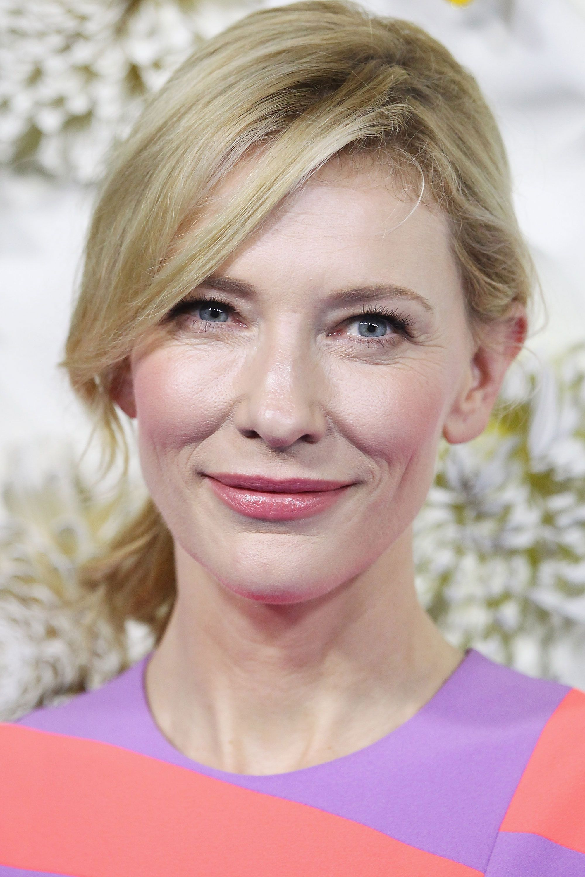 Blanchett is a breath of fresh air with her perky pink cheeks and petal-painted lips.