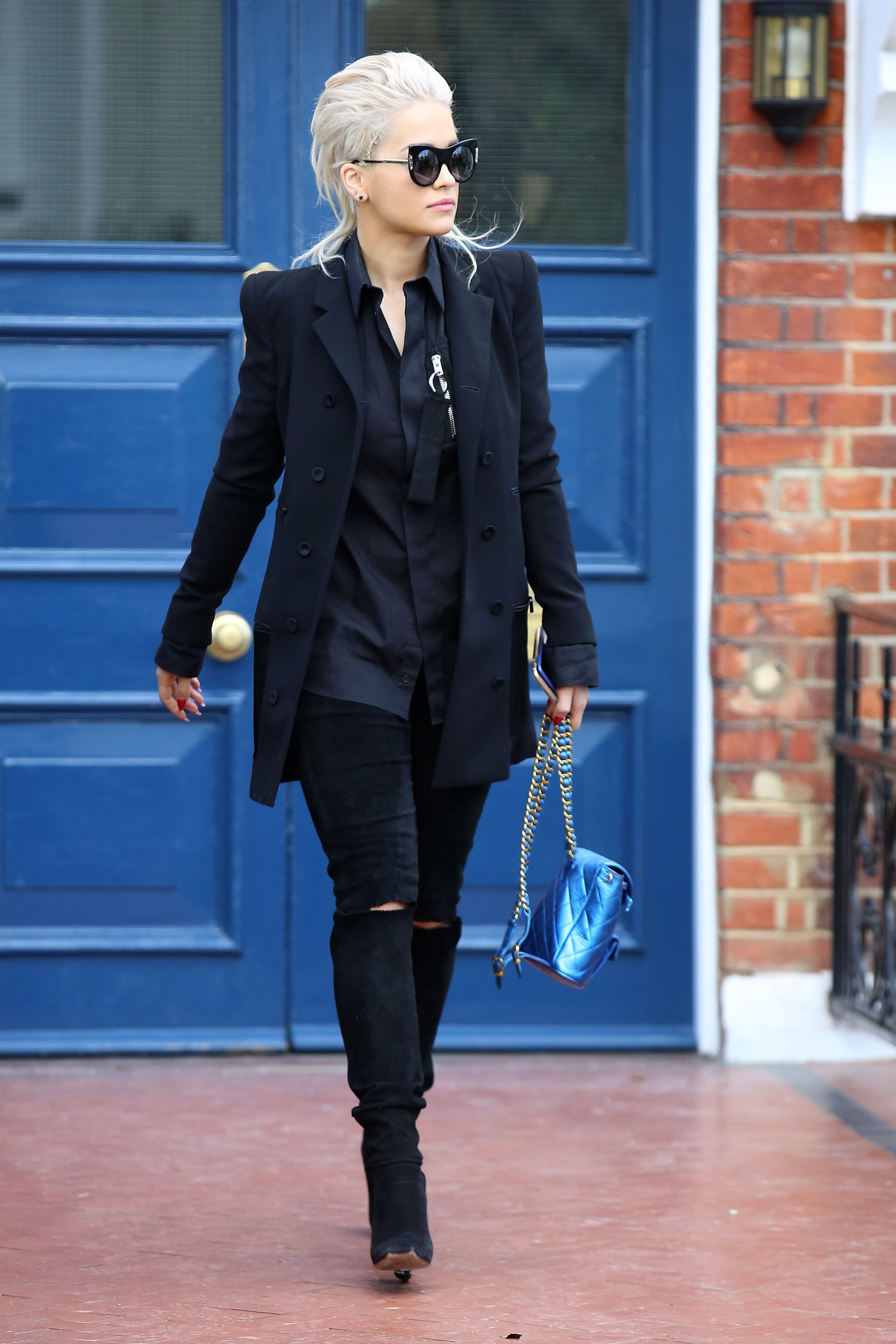 Who: Rita Ora  When: 3/26/2015  Why: All black everything is pretty much the key to looking chic. Adding a little blue metallic bag accent? Now that's style.